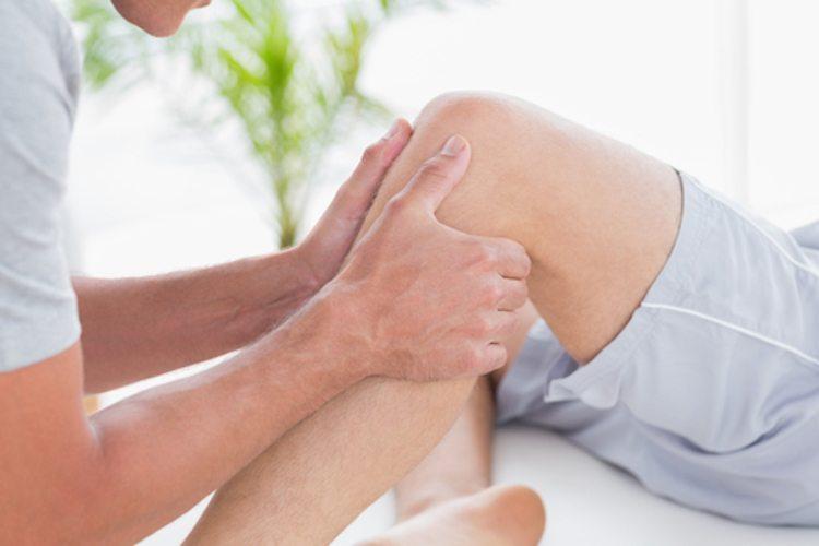 Man having knee massage in medical office